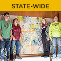 "Statewide (Photo: Maquoketa students with ""We All Perform,"" which they contributed to)"