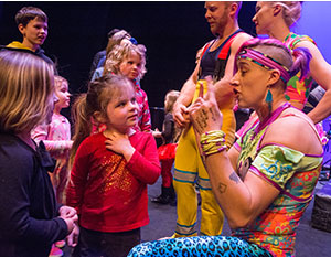Acrobats from Circus Oz speak with young fans at a Hancher donor event